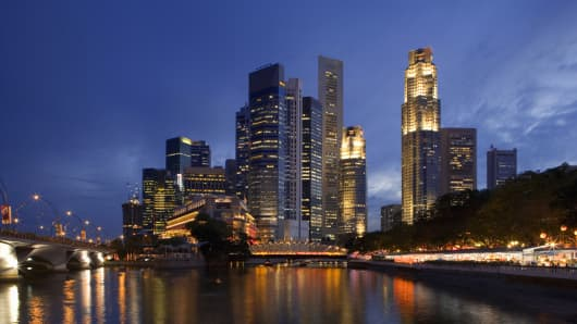 Singapore's business district skyline at dusk