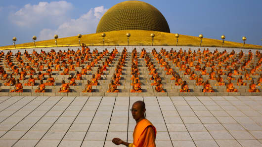 Thai Buddhist monks offer prayers celebrating Magha Puja day at Wat Dhammakaya.