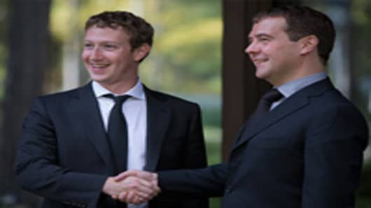 Russia's Prime Minister Dmitry Medvedev (R) and Facebook CEO Mark Zuckerberg shake hands as they meet at the Gorki residence outside Moscow, on October 1, 2012.