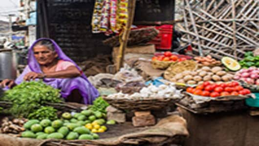 Local vendors sell vegetables at a local market in Aminabad in Lucknow, Uttar Pradesh, India.
