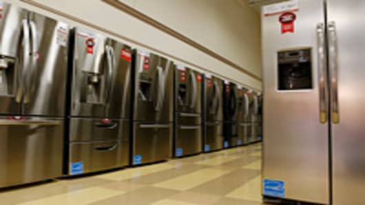 Refrigerators stand on display at a Conn's Inc. store in Houston, Texas, U.S., on Tuesday Sept. 4, 2012.