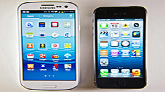 The Apple Inc. iPhone 5, right, and the Samsung Electronics Co. Galaxy S III