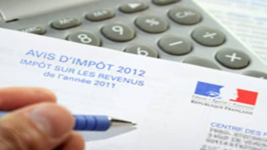 A person fills out a tax declaration for the 2012 income tax on September 10, 2012 in Lille, northern France.