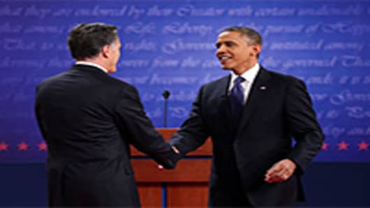 Democratic presidential candidate, U.S. President Barack Obama (R) shakes hands with Republican presidential candidate, former Massachusetts Gov. Mitt Romney (L).