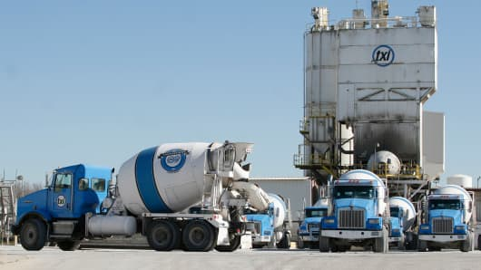 Cement trucks sit outside a Texas Industries Inc. plant in Dallas, Texas, U.S., on Tuesday Jan. 3, 2012.