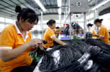 Labors work at a factory&#039;s workshop in Huaying, Sichuan province of China.
