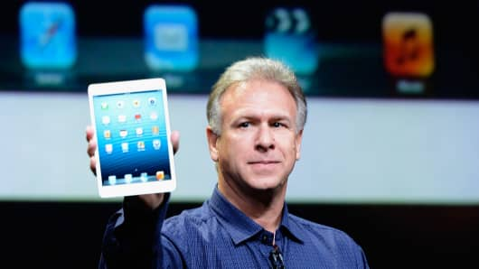 Apple Senior Vice President of Worldwide product marketing Phil Schiller announces the new iPad Mini during an Apple special event at the historic California Theater on October 23, 2012 in San Jose, California.