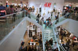 Customers shop during the grand opening of a Hennes &amp; Mauritz AB (H&amp;M) store in Denver, Colorado, U.S., on Thursday, Nov. 10, 2011.