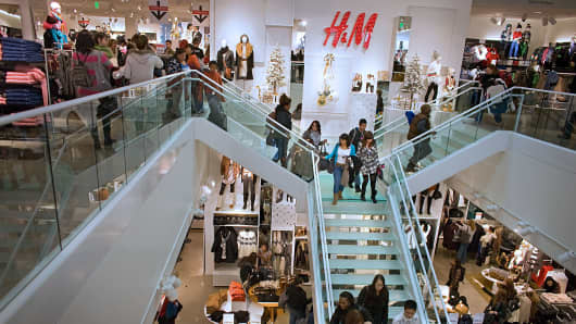 Customers shop during the grand opening of a Hennes & Mauritz AB (H&M) store in Denver, Colorado, U.S., on Thursday, Nov. 10, 2011.