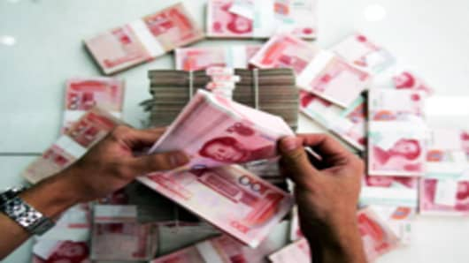 China Needs to Float Yuan to Avoid Global Recession: Swan