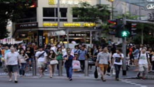 Shoppers in Singapore's main shopping district Orchard Road