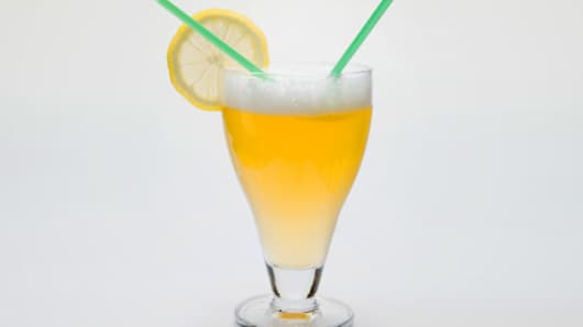 Glass of shandy with slice of lemon
