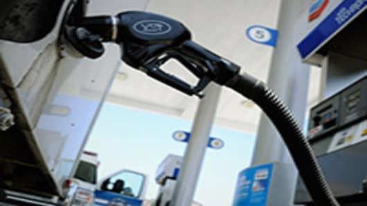 Customers pump gas.