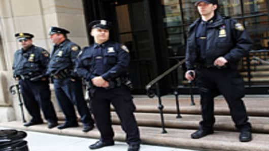 Police stand in front of the Federal Reserve Bank on October 17, 2012 in New York City. A Bangladeshi national was arrested Wednesday by Federal Authorities for allegedly