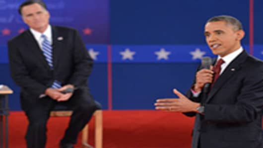 U.S. President Barack Obama and Republican presidential candidate Mitt Romney participate in the second presidential debate at Hofstra University.