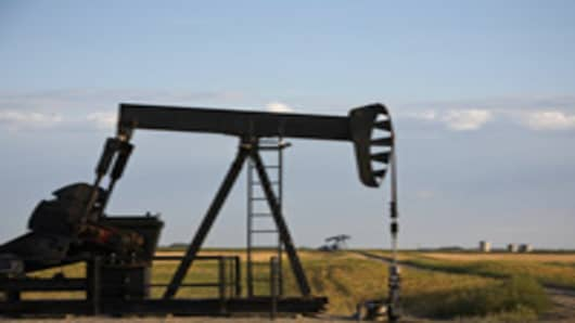 Oil derricks in North Dakota pump oil from
