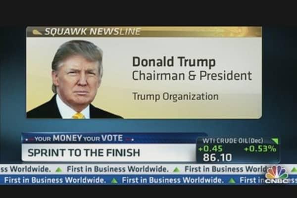 Trump Casts His Ballot For Romney
