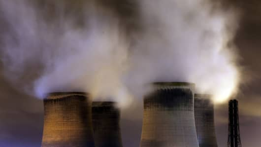 Nuclear power towers with steam at night