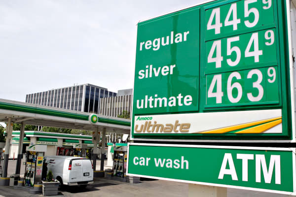 A customer fills his tank at a gas station on the north side of Chicago, Illinois.