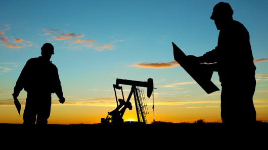 oil worker and derrick silhouette