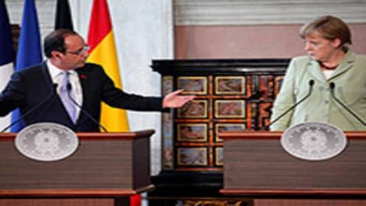 Euro Zone Crisis Straining Hollande and Merkel's Unity