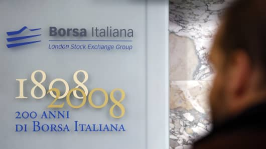 A visitor looks at a plaque commemorating the 200th anniversary of the Borsa Italiana, inside Italy's stock exchange, which is part of the London Stock Exchange Group Plc, in Milan, Italy.