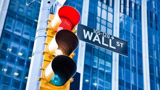 Wall Street sign and streetlight