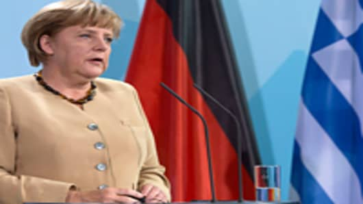 Merkel Did 'Bare Minimum' to Keep Greece Solvent: Analysts