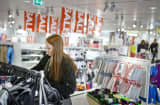 A customer browses garments for sale inside a Hennes & Mauritz AB (H&M) store in Stockholm, Sweden, on Tuesday, Jan. 29, 2013.