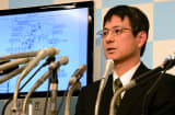 Japan Meteorological Agency officer Makoto Saito shows a map of northern Japan and speaks about an earthquake at the agency in Tokyo on December 7, 2012.