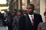 Applicants line up in the cold to meet potential employers at the Diversity Job Fair on December 6, 2012 in Manhattan, New York City.