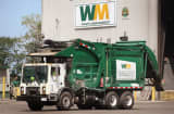 A driver backs his truck into a bay at a Waste Management trash processing facility in Cicero, Illinois.