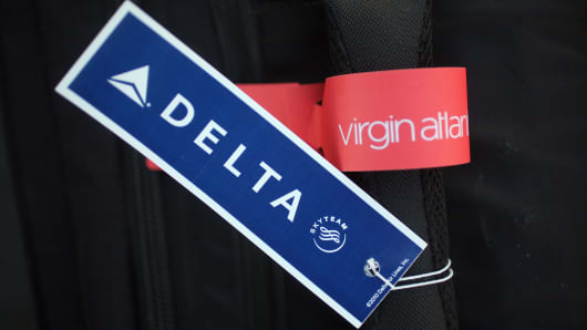 Delta Airlines baggage tags are affixed on the handle of luggage on December 11, 2012 in Manchester, England.