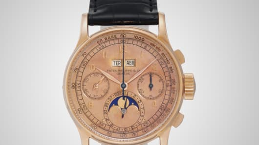 A signed Patek Philippe wrist watch with moon phases and pink dial goes up for auction at Christie's New York.