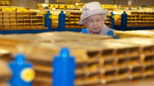 Queen Elizabeth II views stacks of gold as she visits the Bank of England with Prince Philip, Duke of Edinburgh on December 13, 2012 in London, England.