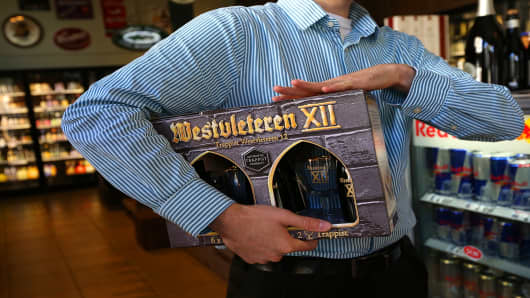 A customer holds a six-pack of Westvleteren 12 at Ales Unlimited on December 12, 2012 in San Francisco, California