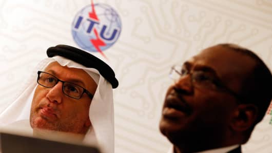 Hamadoun Toure, Secretary-General of the International Telecommunication Union (ITU), speaks during a press conference as Mohamed al-Ghanim, Chairman of the World Conference on International Telecommunication listens on during the final day of the WCIT-12 in Dubai.