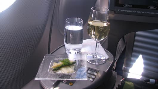 Lufthansa First Class drink service.