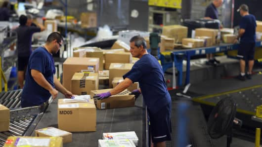 FedEx employees sort through items being shipped through the Fedex World Service Center.