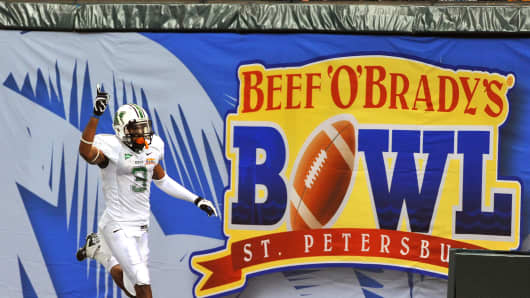 Wide receiver Aaron Dobson #3 of the Marshall Thundering runs 39 yards with a pass in the fourth quarter for a touchdown against the Florida International University Panthers December 20, 2011 in the Beef 'O' Brady's St. Petersburg Bowl in St. Petersburg, Florida.