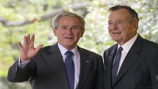 Former US President George W. Bush, left, with his father and former US President, George H. W. Bush.