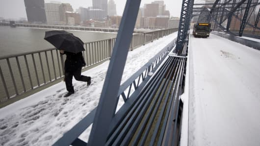 A pedestrian crosses the Smithfiled Street Bridge in Pittsburgh.