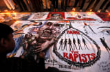 A poster at a protest against the gang rape of a 23-year-old in New Delhi, India