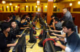 Groupe of people at an internet cafe in Jiashen, east China's Zhejiang province.