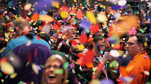 Confetti drops on traders and clerks at the CME.