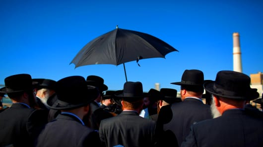 Ultra-Orthodox Jews pray  in Tel Aviv, Israel.