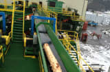 A log moves along the conveyor belt for processing in Idaho Forest Group&rsquo;s Athol, Id. sawmill.