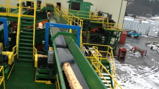 A log moves along the conveyor belt for processing in Idaho Forest Group's Athol, Id. sawmill.