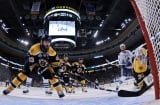 ZZdeno Chara #33 and Tim Thomas #30 of the Boston Bruins defends the net against the Vancouver Canucks during Game Six of the 2011 NHL Stanley Cup Final.
