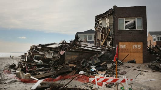 A destroyed home is viewed along the beach in the Belle Harbor neighborhood of New York City.